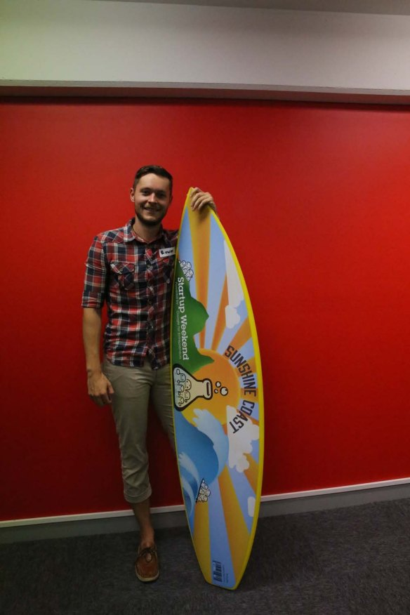 Posing with the promotional surfboard.