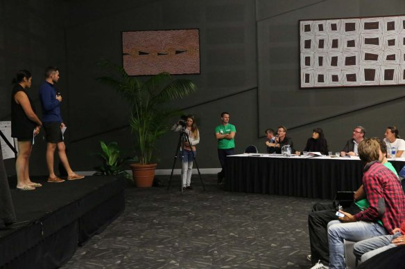 Answering the judges questions.